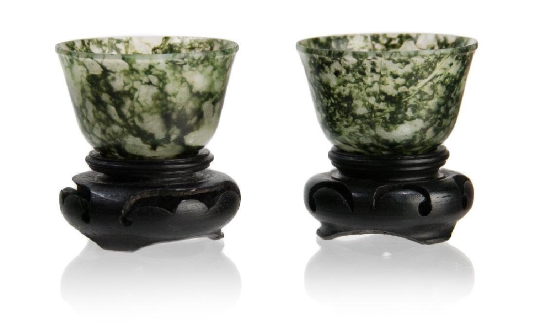 PAIR OF CARVED JADE WINE CUPS ON STANDS