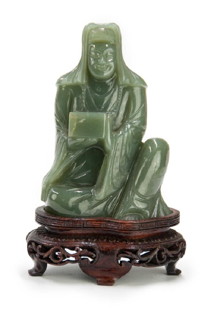 CARVED JADE SEATED SCHOLAR; MING DYNASTY