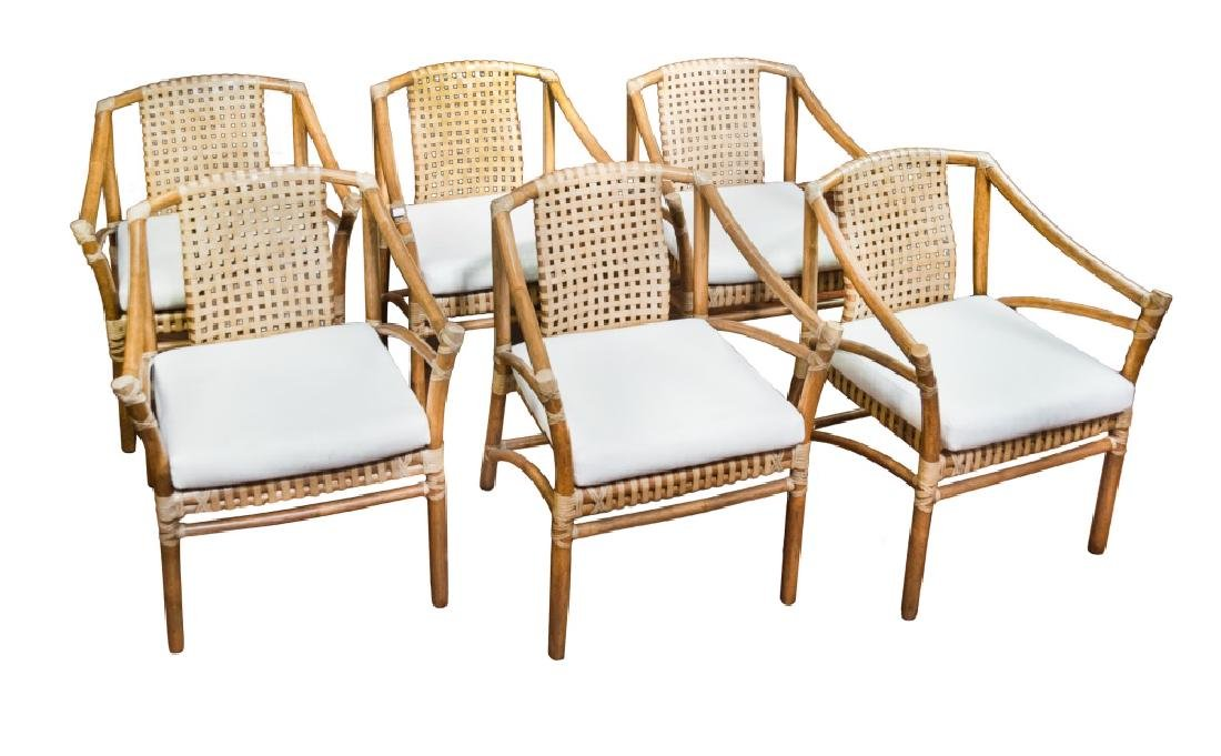 SET OF SIX WOOD AND LEATHER HIDE CHAIRS