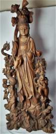 A DELICATE WOOD CARVED FIGURE OF GUANYIN