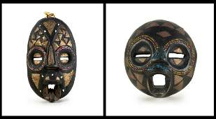 TWO CARVED WOOD AFRICAN MASKS