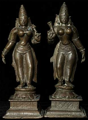 Near pair of well-cast Indian bronze figures.