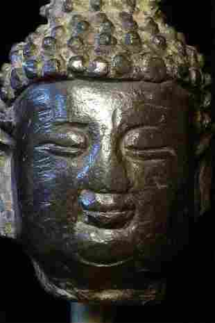 Ming bronze Buddha head. Stands 5 inches total height