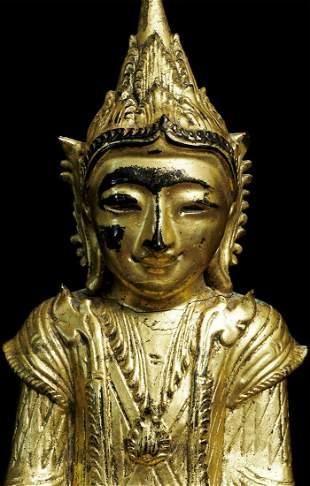 Antique lacquer Burmese Buddha in Royal attire.