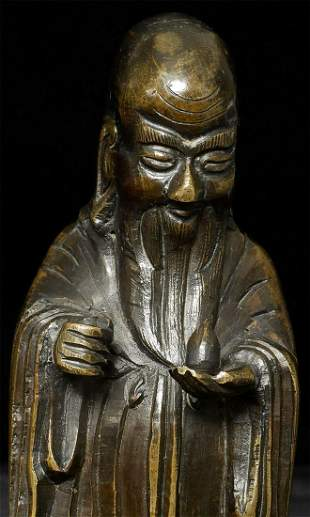 Antique Chinese Bronze Deity. Stands 6 5/8 inches tall