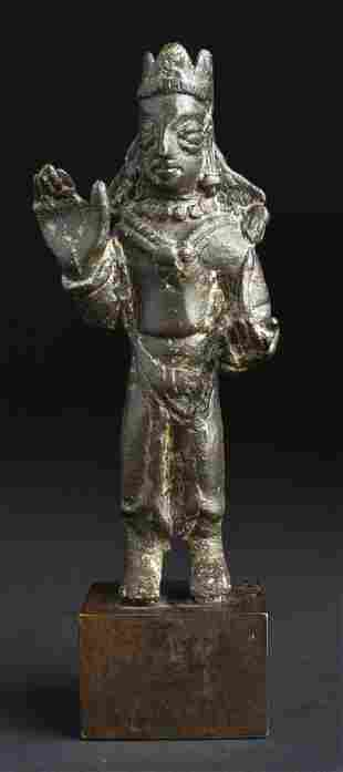 A bronze figure of Buddha Avalokitesvara crowned and