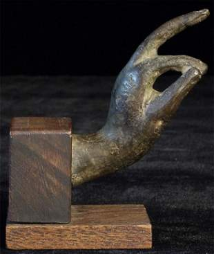 Small antique bronze Thai Buddha hand. Sits 3.75 inches