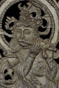 Vintage/old metal screen with celestial deity with