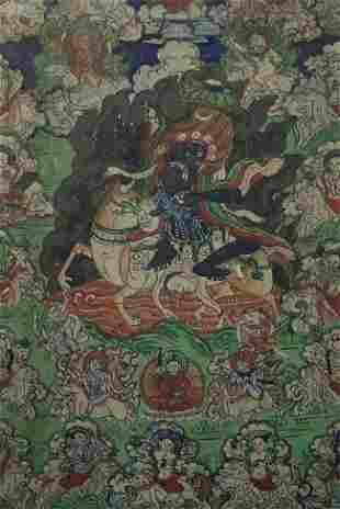 Intricate antique Mongolian Thangka in old frame.