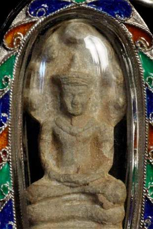 Authentic antique Thai Naga Buddha Amulet in modern