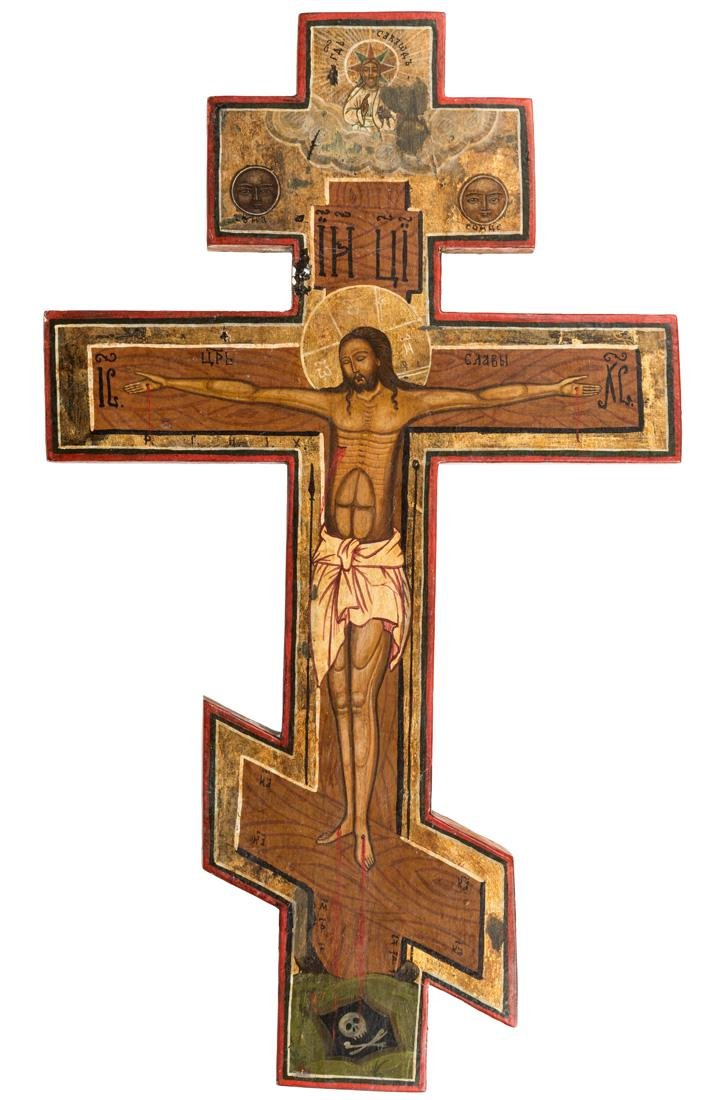 A RUSSIAN SHAPED ICON OF THE CRUCIFIXION, 19TH CENTURY