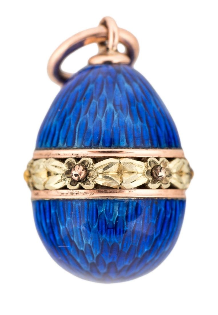 A FABERGE GOLD AND GUILLOCHE ENAMEL EGG PENDANT, MARKED