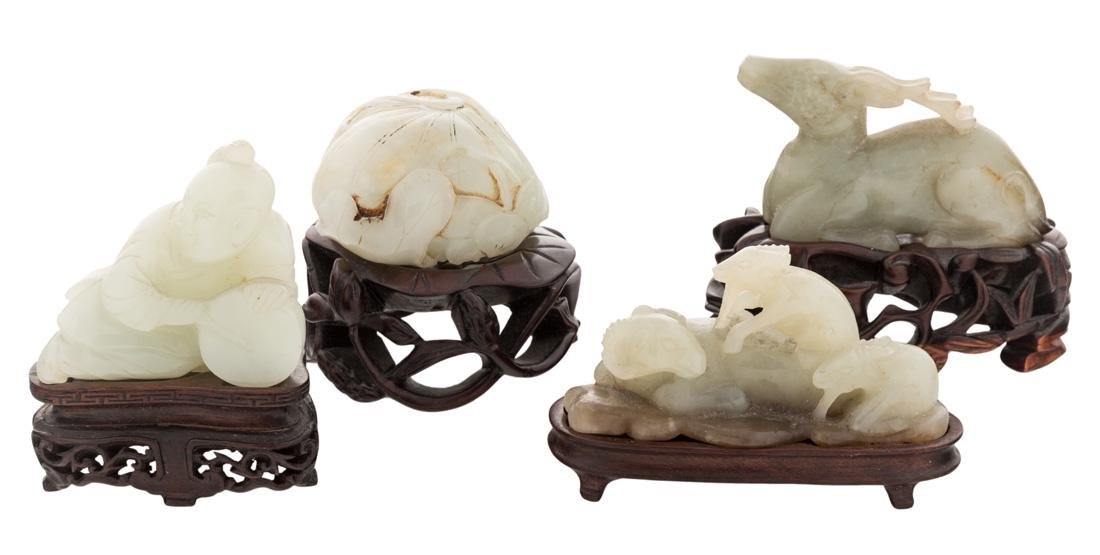 FOUR CHINESE WHITE JADE FIGURES ON STANDS (LATE QING