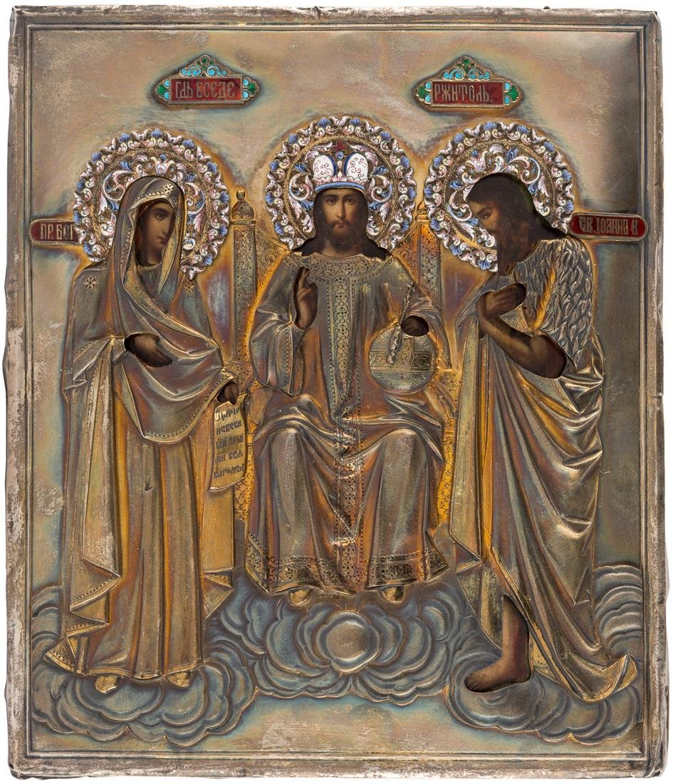 A RUSSIAN ICON WITH THE DEESIS IN A GILT SILVER AND