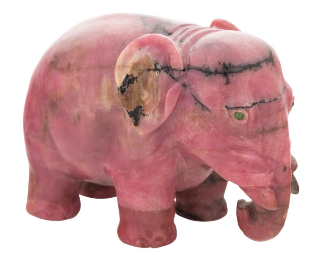 A RUSSIAN RHODONITE MODEL OF AN ELEPHANT, CIRCA 1900