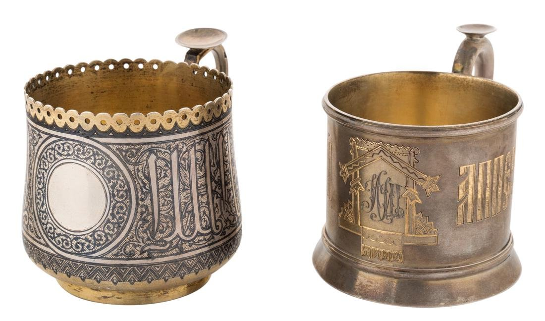 A PAIR OF RUSSIAN SILVER GILT AND NIELLO CUP HOLDERS