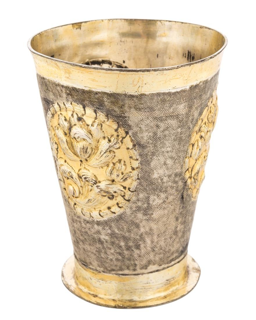 A RUSSIAN SILVER-GILT BEAKER REPOUSSE WITH FLOWERS,