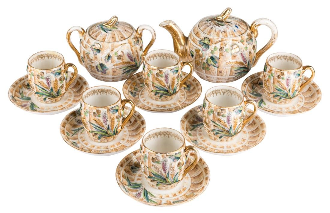 A FOURTEEN-PIECE RUSSIAN PORCELAIN TEA-SET,