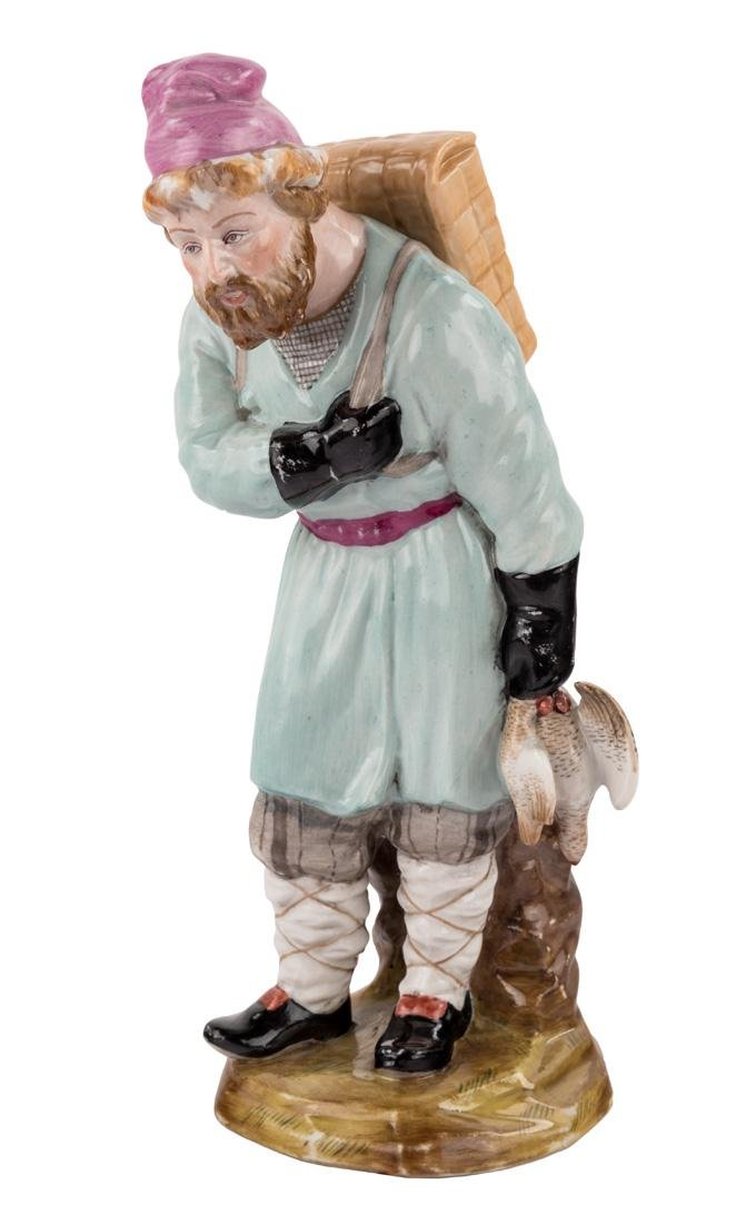A RUSSIAN IMPERIAL PORCELAIN FIGURE OF A BIRDCATCHER,