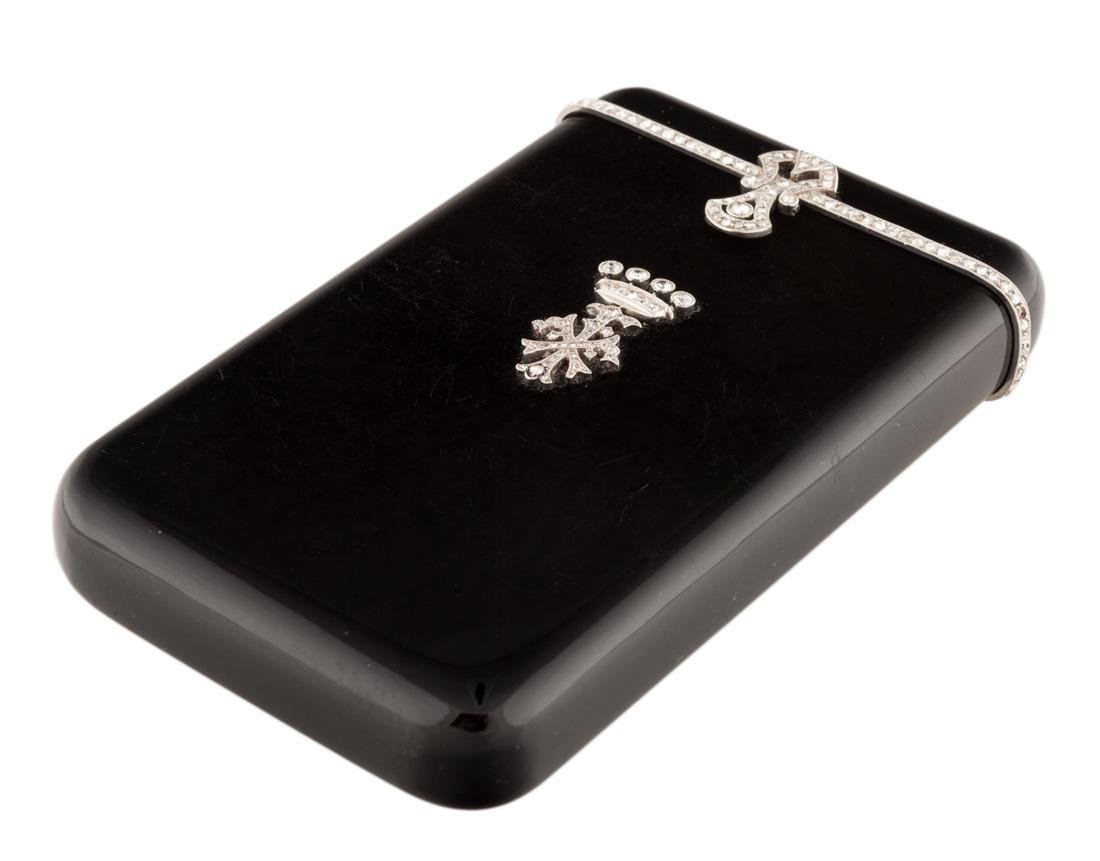 AN EARLY 20TH CENTURY ONYX AND DIAMONDS CIGARETTE CASE