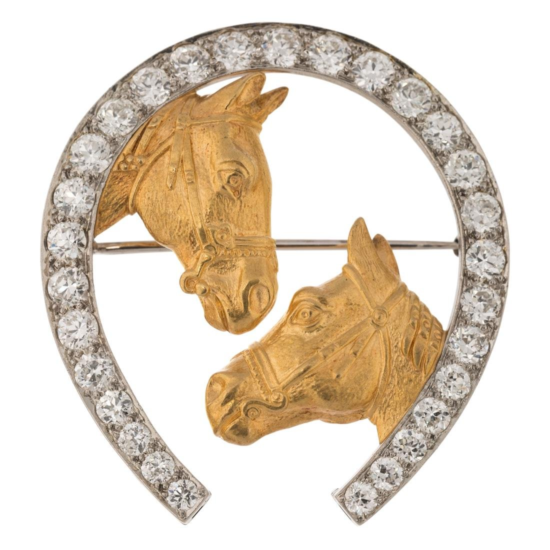 DIAMOND AND GOLD BROOCH IN A FORM OF HORSESHOE, LATE