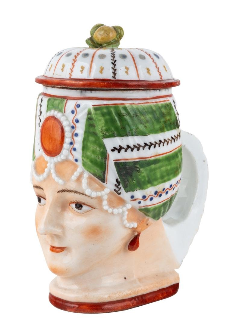 A RUSSIAN PORCELAIN FIGURAL MUG IN THE FORM OF AN