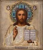 A RUSSIAN ICON OF CHRIST PANTOCRATOR WITH GILT SILVER