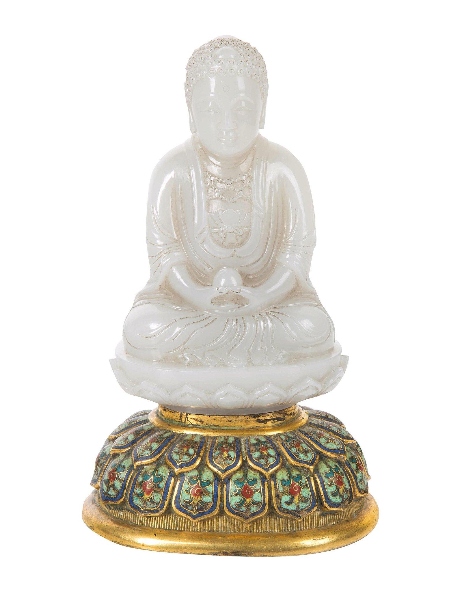 A CHINESE WHITE JADE FIGURE OF BUDDHA SHAKYAMUNI WITH