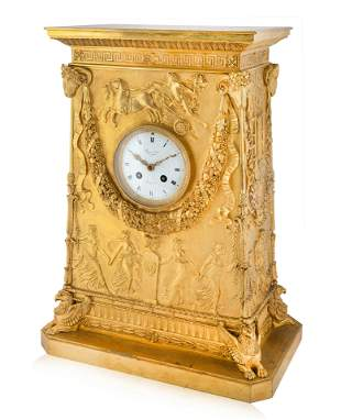 A FRENCH EMPIRE-STYLE GILT BRONZE MANTEL CLOCK,  MODEL
