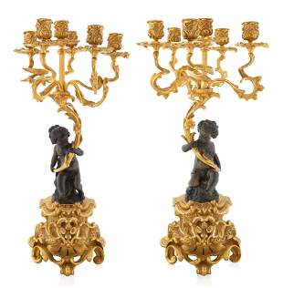 A PAIR OF FRENCH LOUIS XV STYLE ORMOLU CANDELABRAS