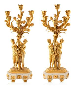 A PAIR OF FRENCH LOUIS XV STYLE CANDELABRAS
