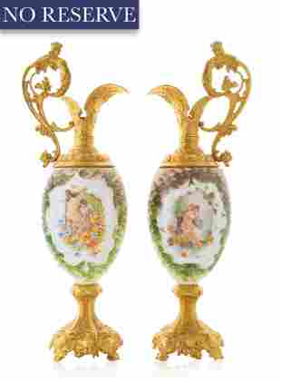 PAIR OF ORMOLU-MOUNTED TWO HANDLED SEVRES STYLE VASES,