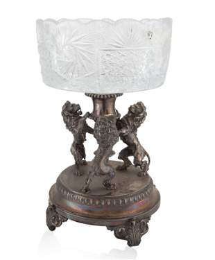 A CONTINENTAL SILVER-PLATED AND GLASS CENTERPIECE,