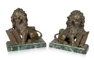 A PAIR OF FRENCH LION BRONZE AND GREEN MARBLE BOOKENDS,