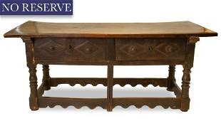 [ROERICH] AN ITALIAN OR FRENCH CARVED WALNUT TABLE