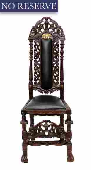 A CARVED WOODEN HIGHBACK CHAIR WITH LEATHER
