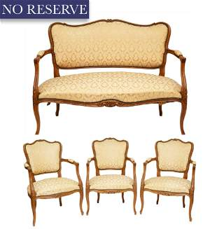 A LOUIS XV-STYLE CARVED WALNUT SILK-DAMASK UPHOLSTERED