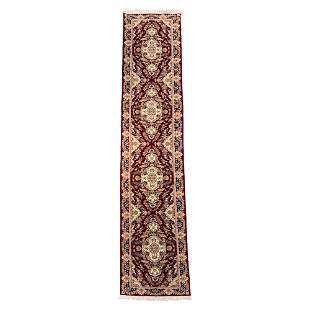 A LARGE IRANIAN WOOL AND SILK HALL RUNNER
