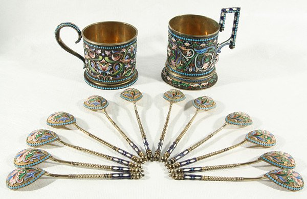 24: A RUSSIAN GILDED SILVER AND CLOISONNE ENAMEL SET WI