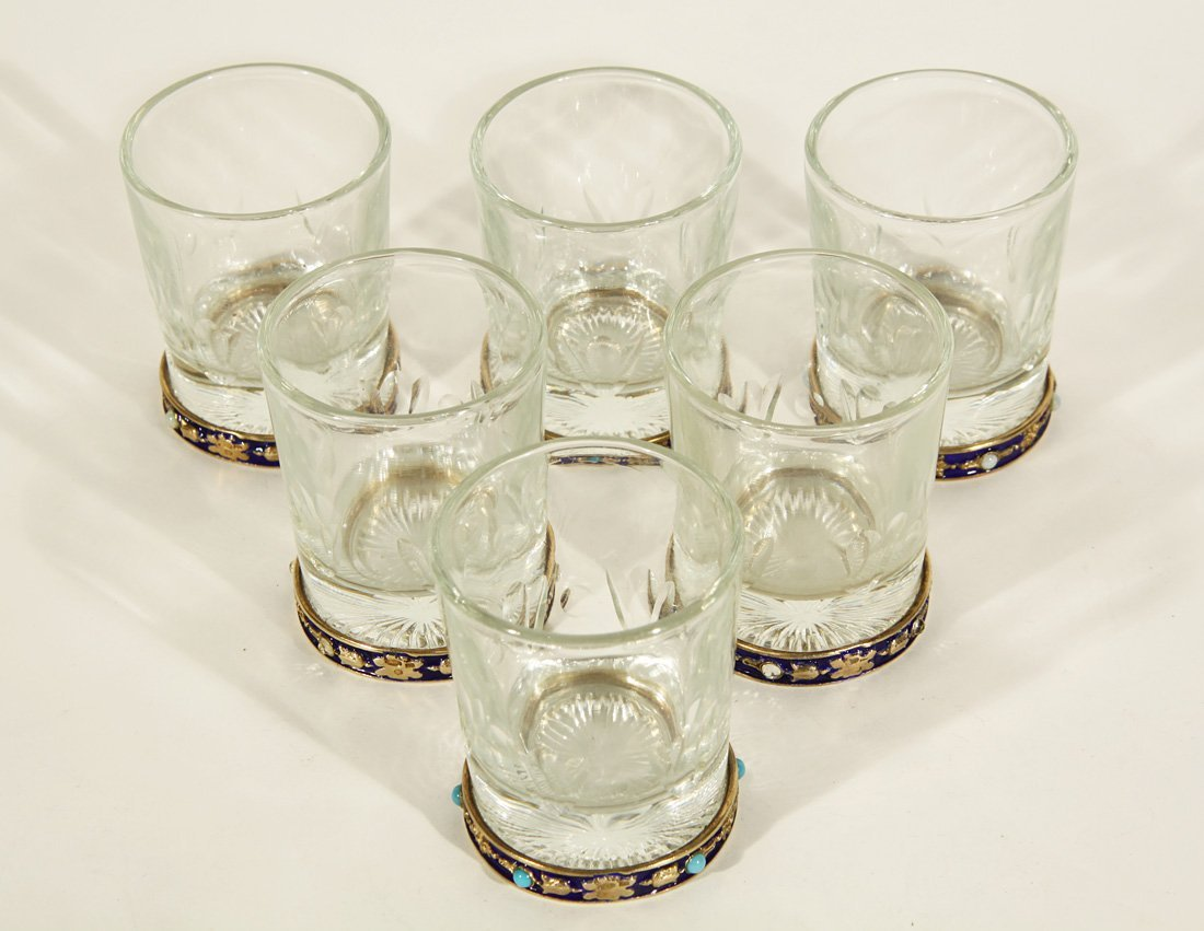 21: A SET OF SIX ENAMELLED SILVER AND CUT GLASS VODKA G