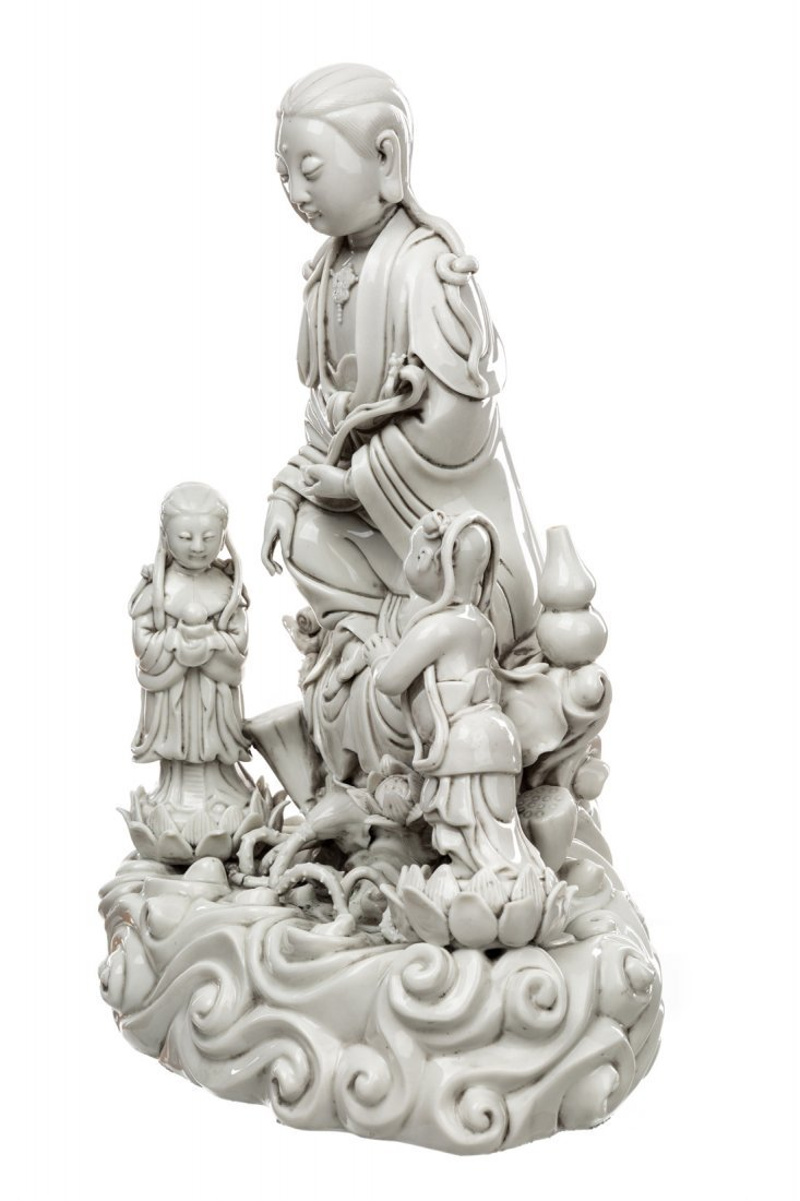 A BLANC-DE-CHINE FIGURE OF GUANYIN ON A ROCK WITH TWO - 2