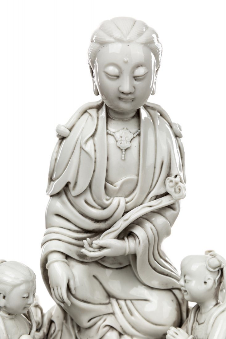 A BLANC-DE-CHINE FIGURE OF GUANYIN ON A ROCK WITH TWO - 3
