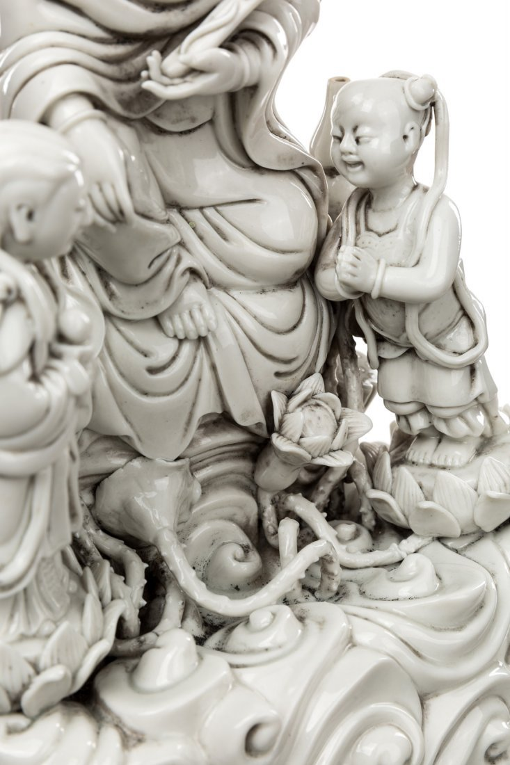 A BLANC-DE-CHINE FIGURE OF GUANYIN ON A ROCK WITH TWO - 4