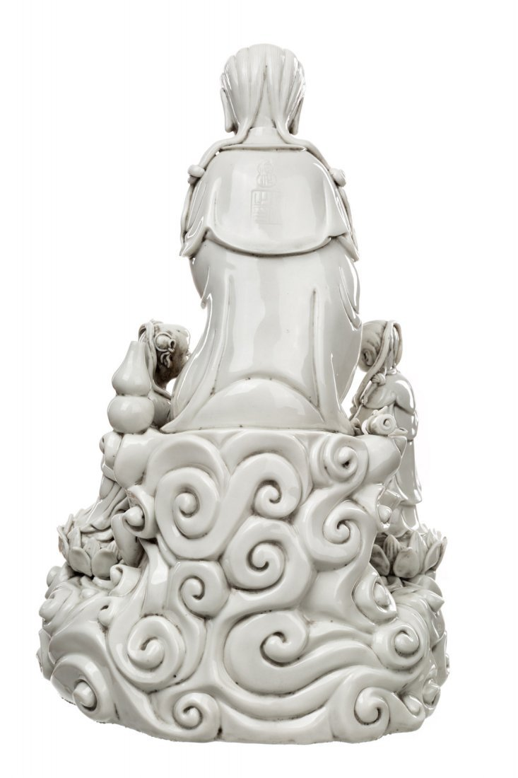 A BLANC-DE-CHINE FIGURE OF GUANYIN ON A ROCK WITH TWO - 5
