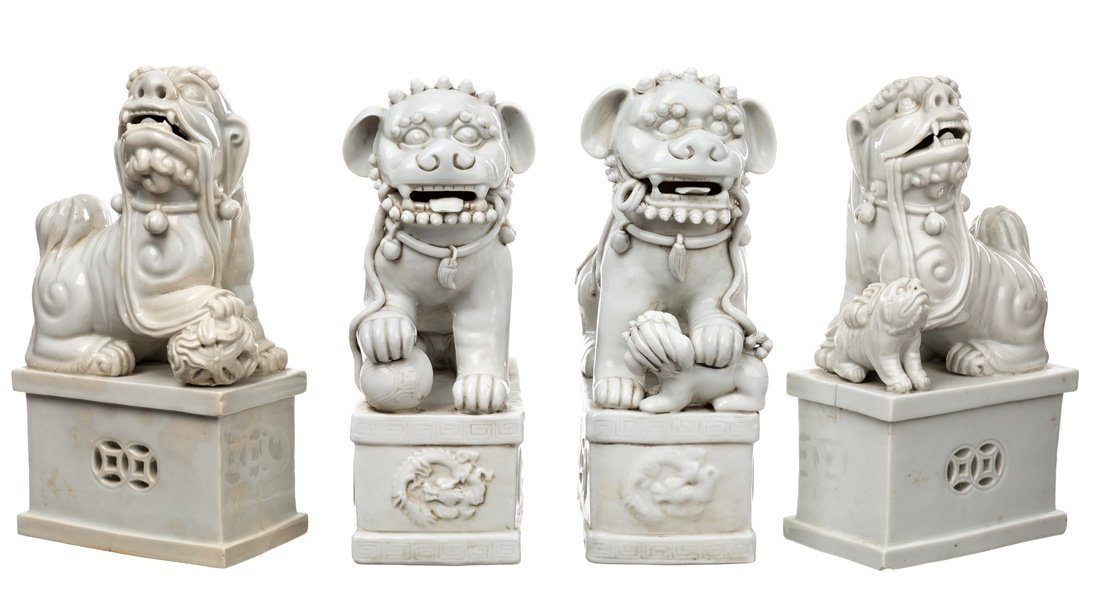 A GROUP FEATURING TWO PAIRS OF BLANC-DE-CHINE LIONS