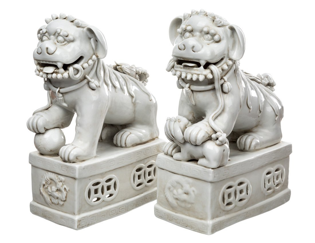 A GROUP FEATURING TWO PAIRS OF BLANC-DE-CHINE LIONS - 2