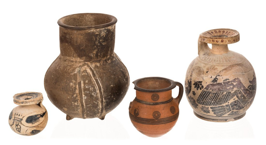 A GROUP OF FOUR ANCIENT TERRACOTTA OBJECTS