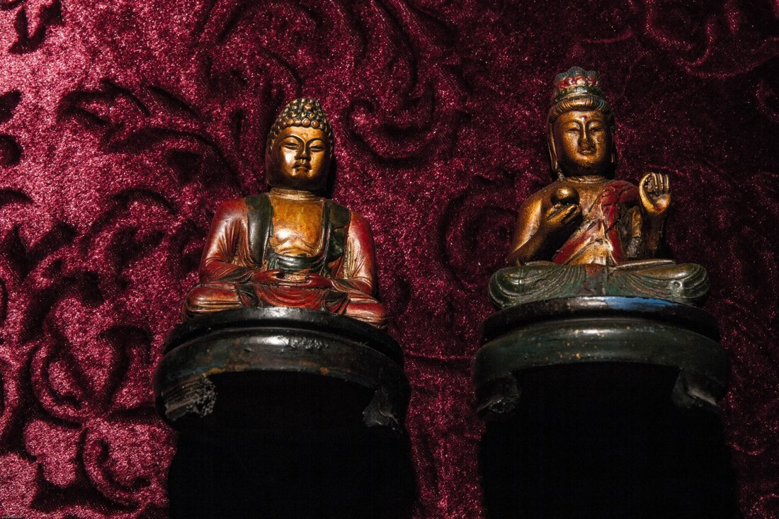 A GROUP OF TWO GILT-LACQUERED WOOD BUDDHA