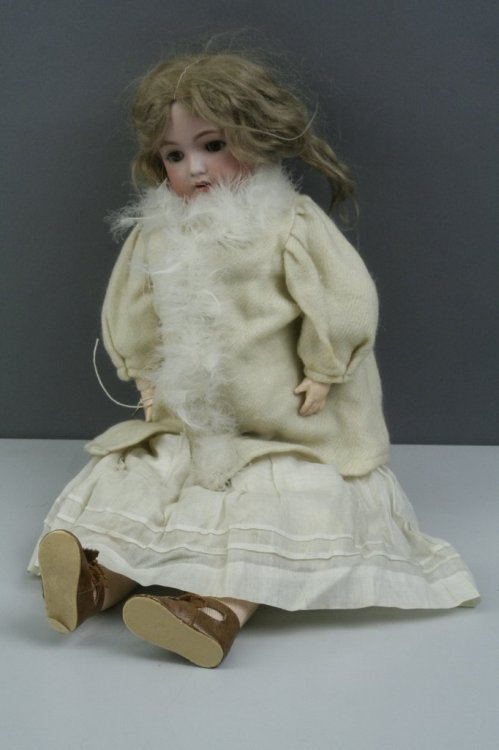 1: A Simon & Halbig bisque doll, 19in. - S & C mark to