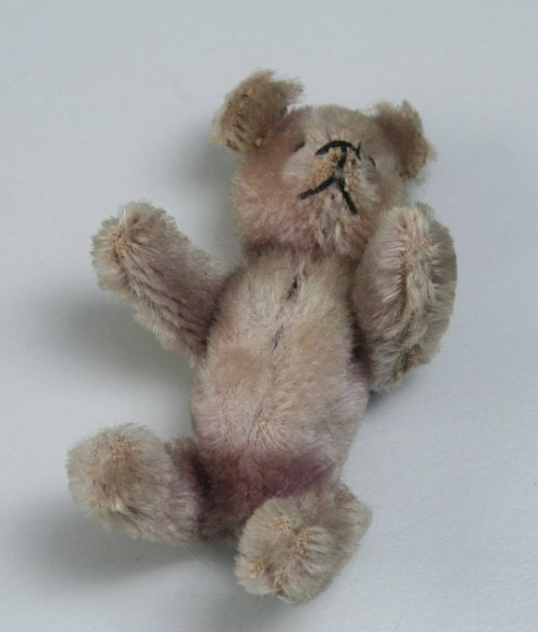 "5: A Schuco ""Piccolo"" series Teddy bear compact, 3.5in."
